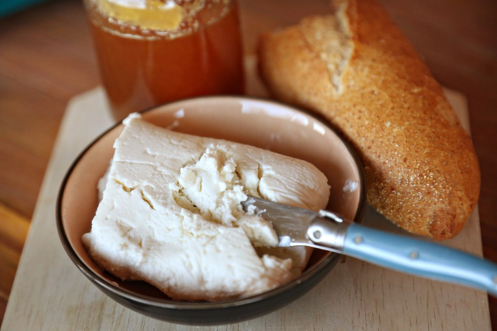 goat cheese with baguette and raw honey