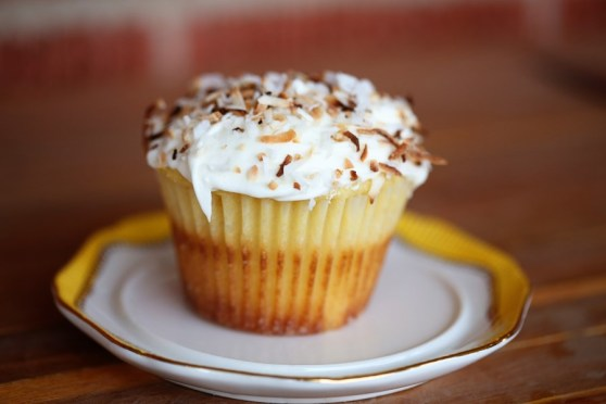 mango cupcake with coconut frosting