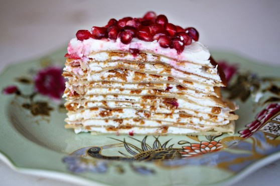 Crepe Cake with Lemon Buttercream, topped with Pomegranate Seeds