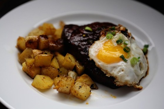 Pork Chops with Home Fries and a Fried Egg