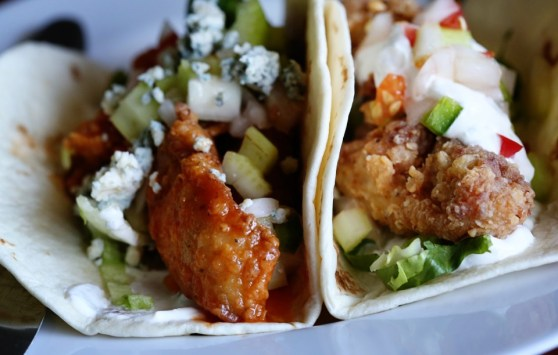 buffalo chicken tacos with blue cheese cream and pico